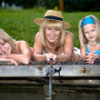 Family fishing at the lake — Stock fotografie