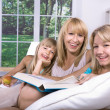 Stock Photo: Family reading a book