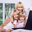 Family with laptop — Stock Photo #6218951