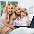 Family with laptop — Foto de Stock