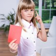 Girl with the red card - Stock Photo
