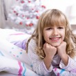 Xmas girl in bed — Stock Photo