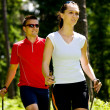 Stock Photo: Nordic walking in forest