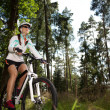 Biking woman — Foto Stock