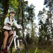 Biking woman — Stock Photo