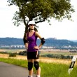 Young woman on rollerblades in the country — Stock Photo #6219458