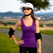 Young woman on rollerblades in the country — Stock Photo #6219460
