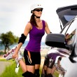 Young woman on rollerblades in the country - Stock Photo
