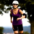 Young woman on rollerblades in the country — Stock Photo #6219472