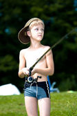 Young boy fishing at a lake — Stock Photo