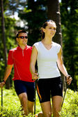 Nordic walking in forest — Stock Photo