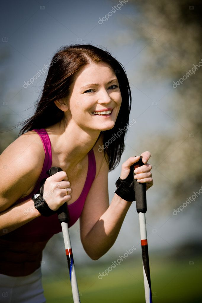 A young woman making nordic walking. outdoor shoot. — Stock Photo #6218443