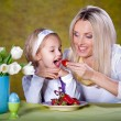 Mother And Daughter Eating strawberry - Stok fotoğraf