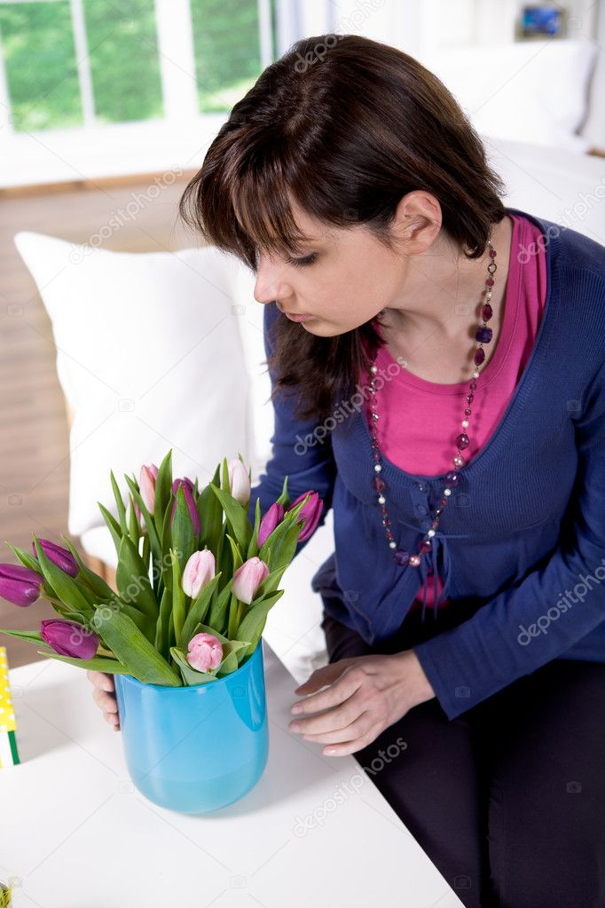 The easter installation. A young wonan with flower.  Stock Photo #6230010