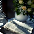Stock Photo: Holy Bible and Flowers on altar in the church
