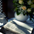 Holy Bible and Flowers on altar in the church — Stock Photo