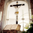 Holy Bible and Flowers on altar in the church — Stock Photo #6253423