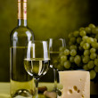 Wine bottle and cheese — Stock Photo