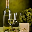 Wine bottle and cheese - Stock Photo