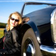 Girl and a classic car — Stock Photo #6255443