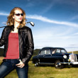 Golf Girl and a classic car — Stock Photo