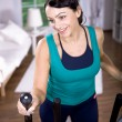 Gym girl on cross-trainer — Stock Photo #6255459