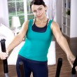 Stock Photo: Gym girl on cross-trainer