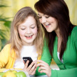 Two girls with a cellphone — Stock Photo #6255510