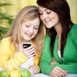 Two girls with a cellphone — Stock Photo #6255511