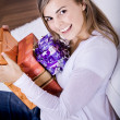 Young woman with gifts — Stock Photo