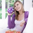 Stock Photo: Young womwith gifts