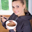Woman with muesli bowl — Stock Photo