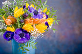 Bunch of anemones and tulips — Stock Photo