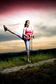 Stretching woman — Stockfoto