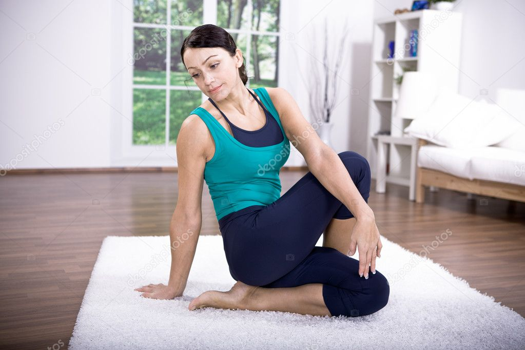 Young woman making yoga exercise at home — Stock Photo #6255461