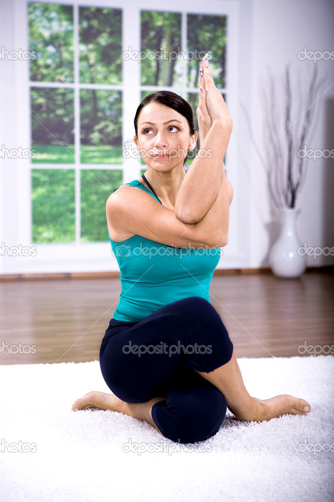 Young woman making yoga exercise at home — Stock Photo #6255465