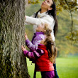 Young family in the autumn park — Stock Photo #6268394