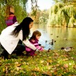 Young family in the autumn park — Stock Photo