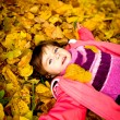 Little girl in autumn park — Stock Photo #6433531