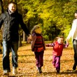 Young family in the autumn park — Stock Photo #6433940