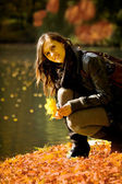 Woman in the autumn park — Stock Photo