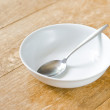Breakfast bowl and spoon — Stock Photo