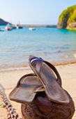 Sandals by the beach — Stock Photo