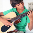 Boy with acoustic guitar — Stock Photo
