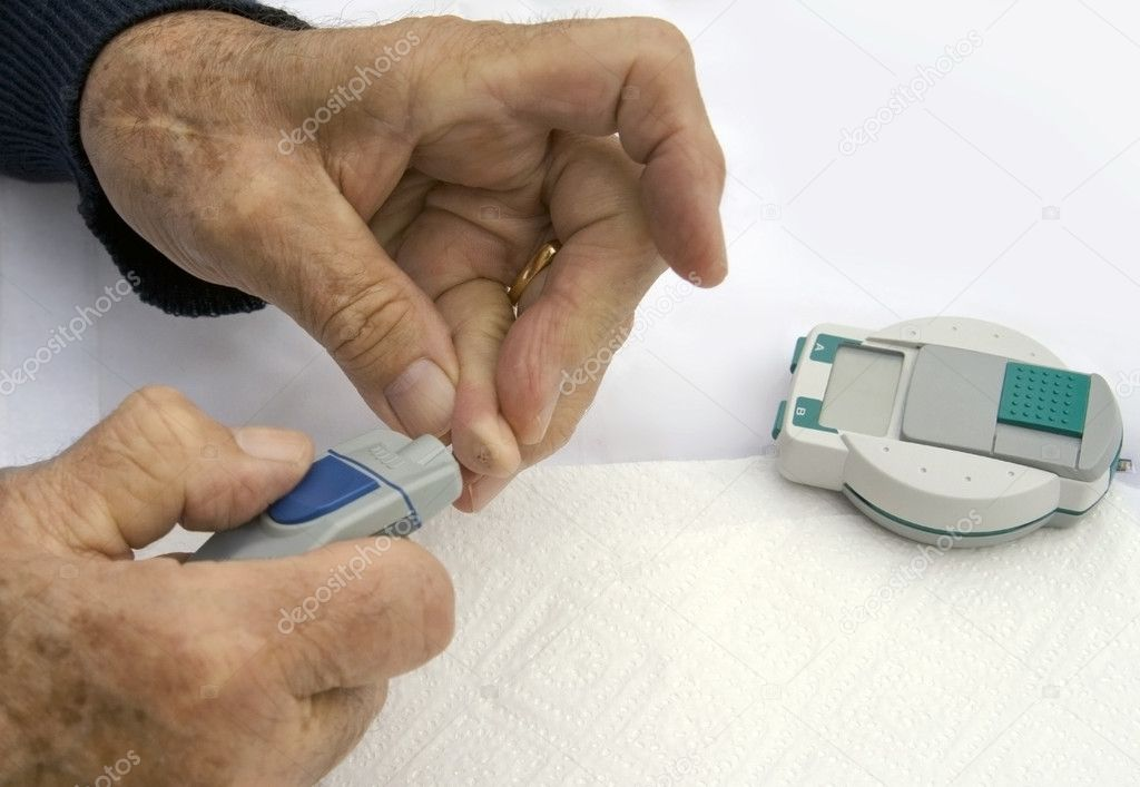Closeup hands of senior diabetic man testing his sugar levela.  Stock Photo #6107092