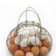 Stock Photo: Eggs on basket 2