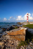 Lighthouse and rusty boat — Stock Photo