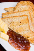 Bread, marmalade and butter, vertical. — Stock Photo