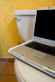 Laptop on WC 3 — Stock Photo