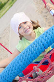 Small girl playing on swing — Stock Photo